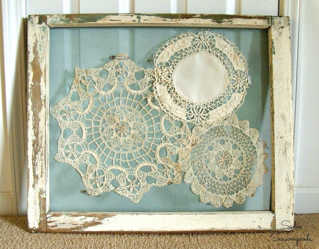 Displaying the vintage doilies with old window frame decorating ideas