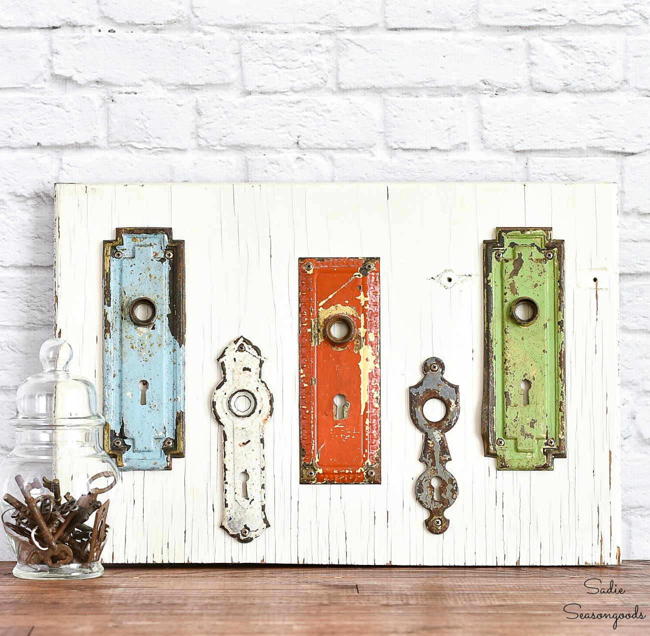 Keyhole Covers and Vintage Hardware as Entryway Wall Decor