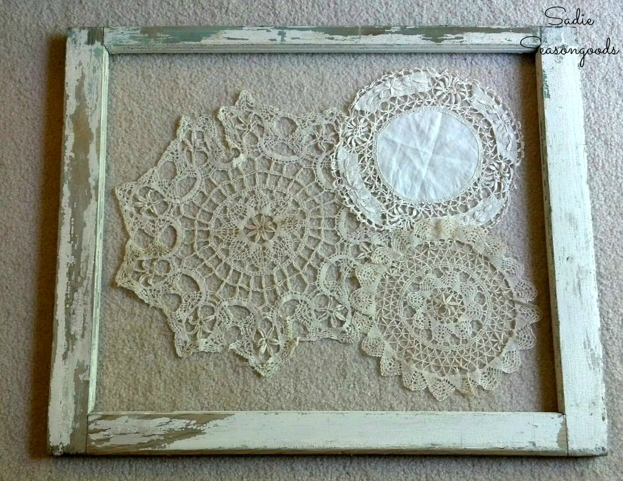 Window frame decor with vintage doilies as shabby chic wall art