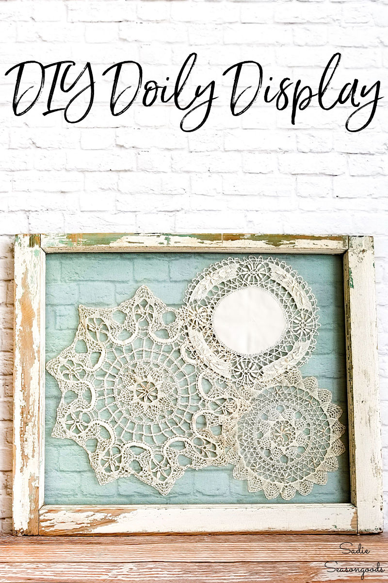 Framed doilies in a vintage window frame