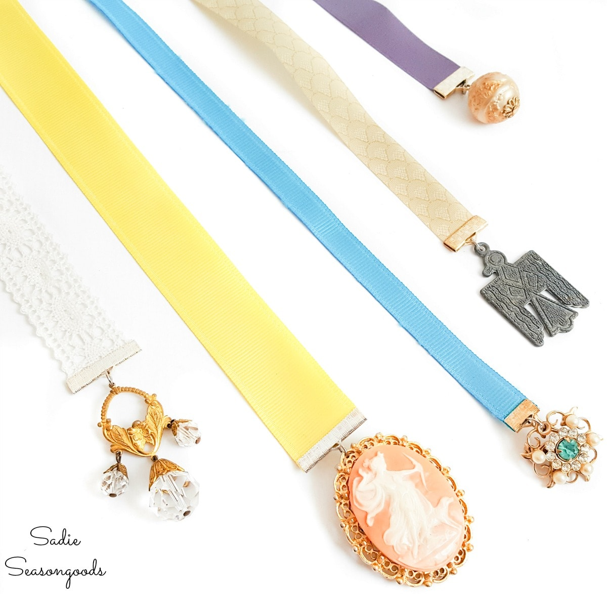 Old jewelry as charms on ribbon bookmarks