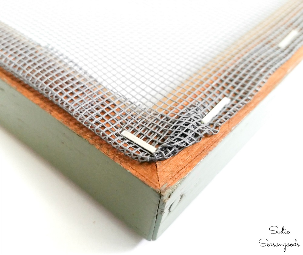 Attaching a window screen to a wooden picture frame