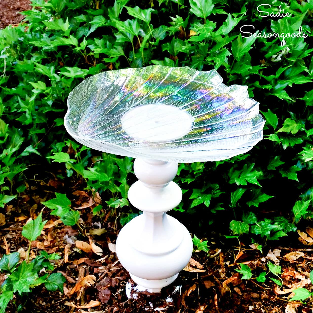 diy birdbath that was made from a vintage lamp and a glass dish