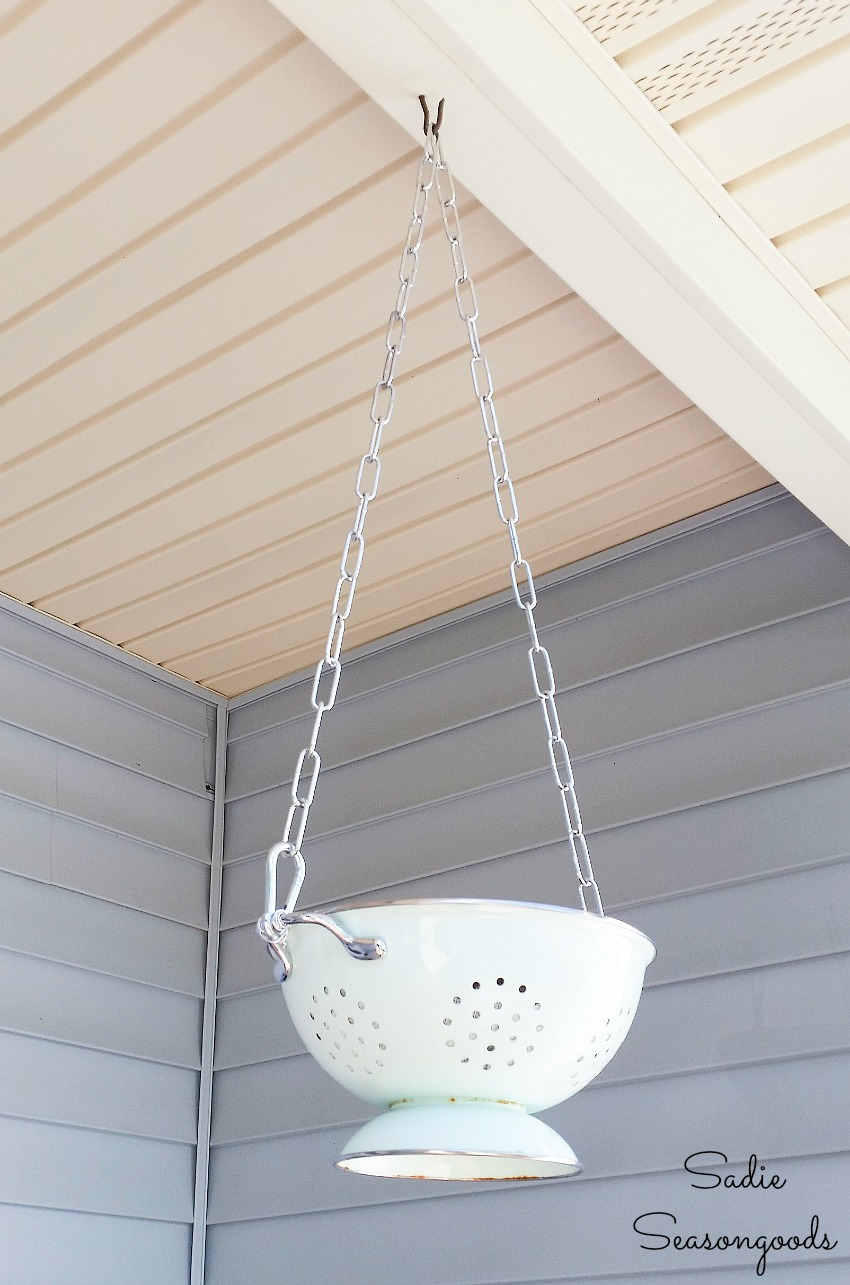 Checking the chain length on an outdoor hanging basket