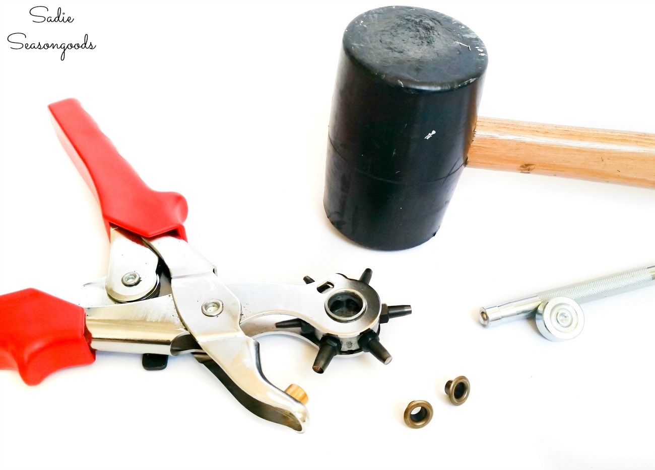 Leather stamping tools and a hole punch for eyelets in a leather belt