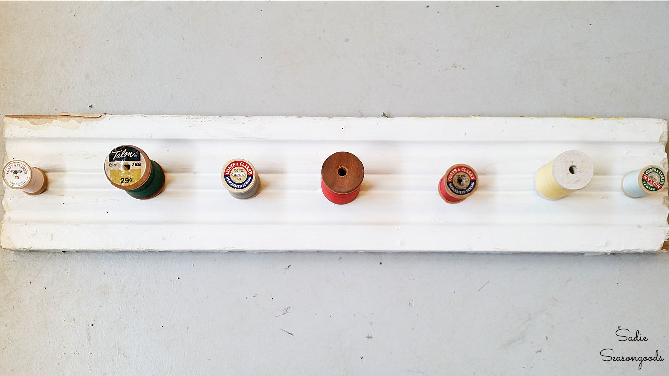making a wooden necklace holder with thread spools