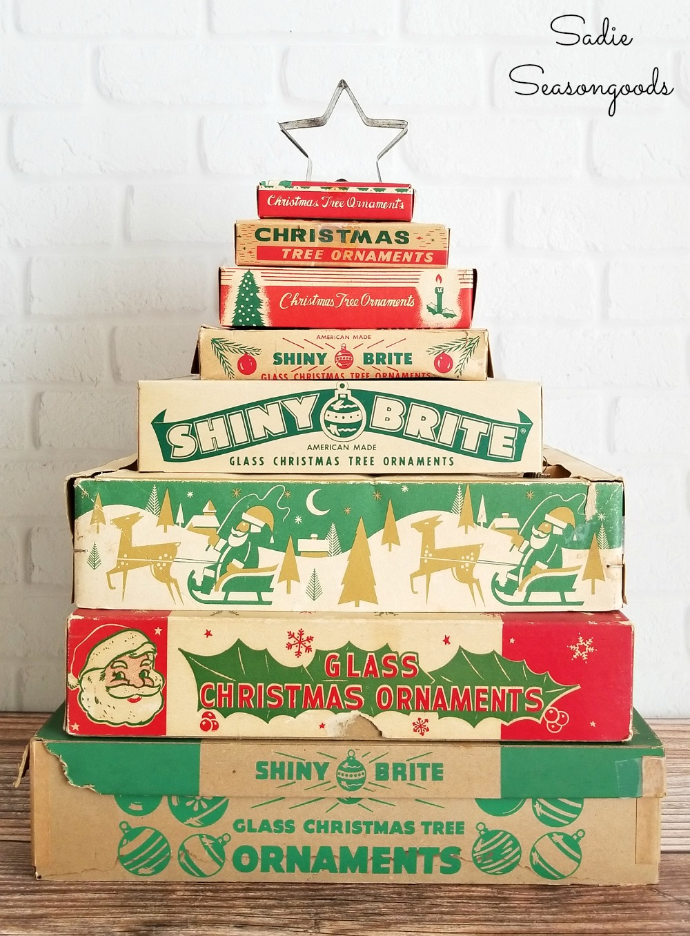 Stacked ornament boxes or vintage ornament boxes stacked together like a Christmas tree to display their vintage graphics for Christmas decor by Sadie Seasongoods / www.sadieseasongoods.com