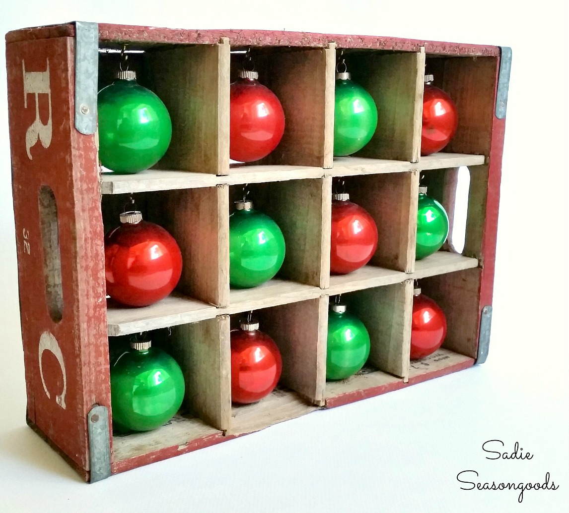 Shiny Brite Ornaments in a bottle crate as an ornament stand for retro Christmas decorations