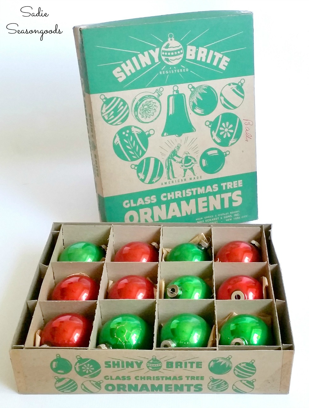 Shiny Brite Ornaments in original box for displaying in a bottle crate