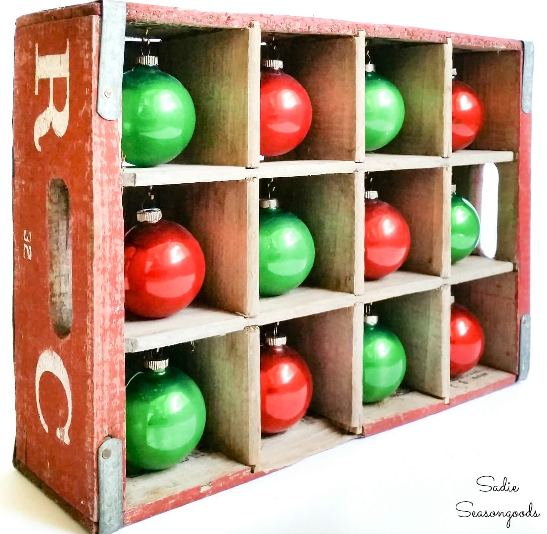 Shiny brite ornaments in a wooden bottle crate