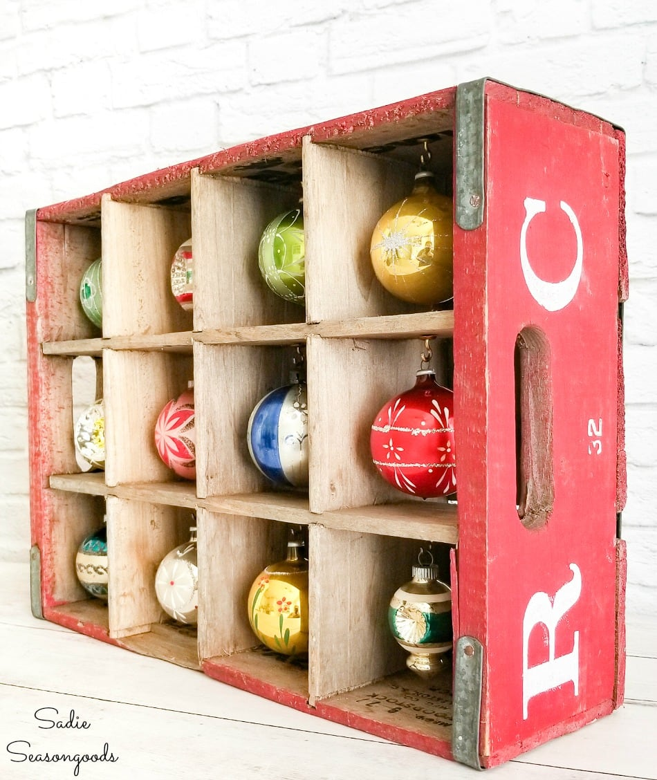 Upcycling a soda crate to display Shiny Brite ornaments