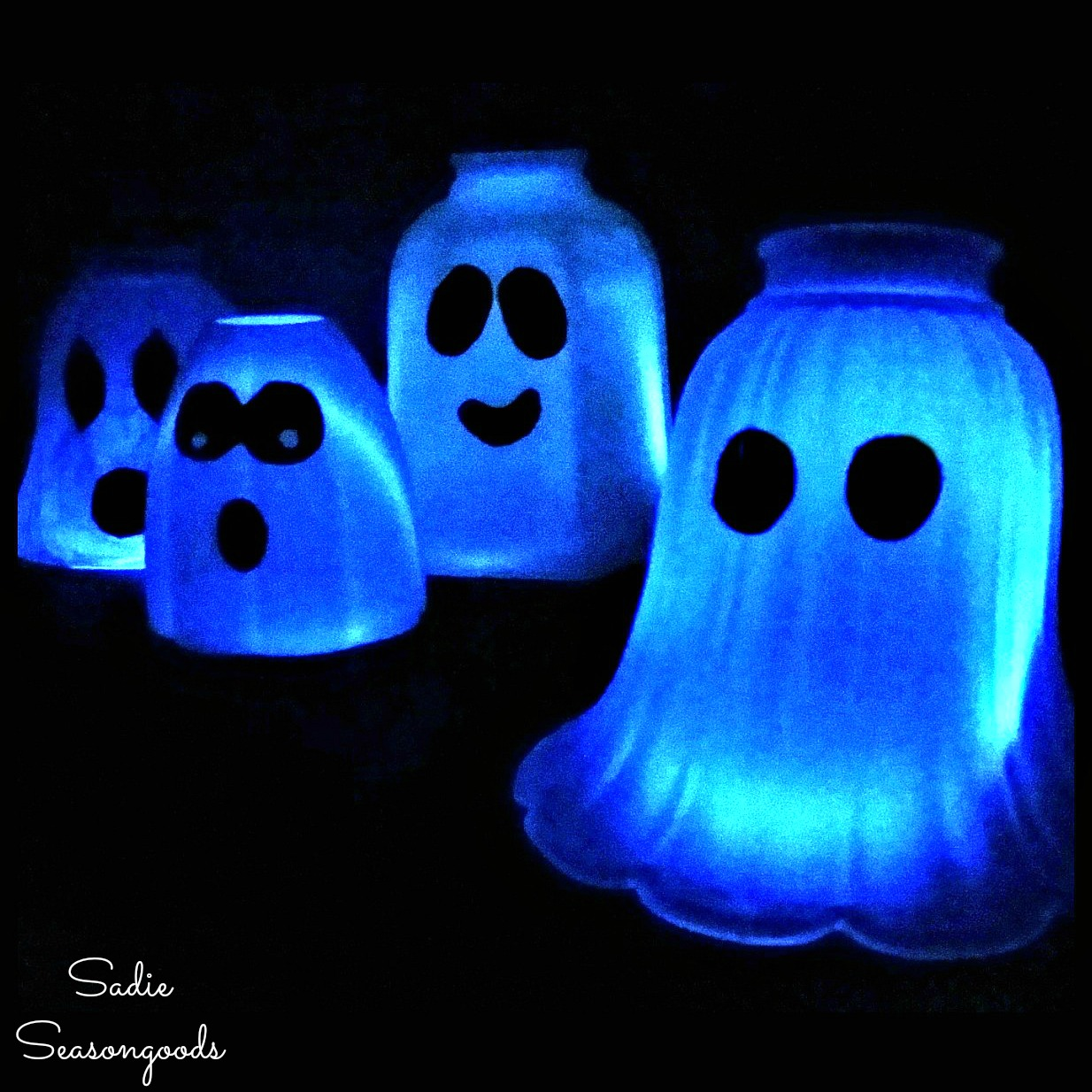 Ghost light for light up Halloween decorations by upcycling the glass light covers with white glowsticks by Sadie Seasongoods