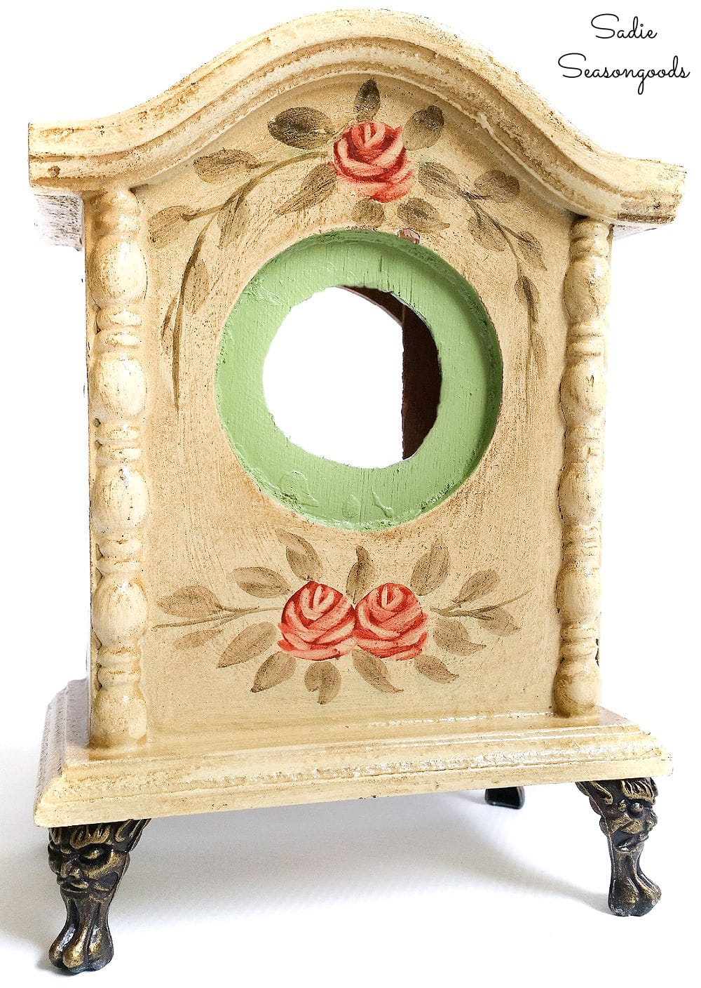 Repurposed birdhouse from a decorative table clock