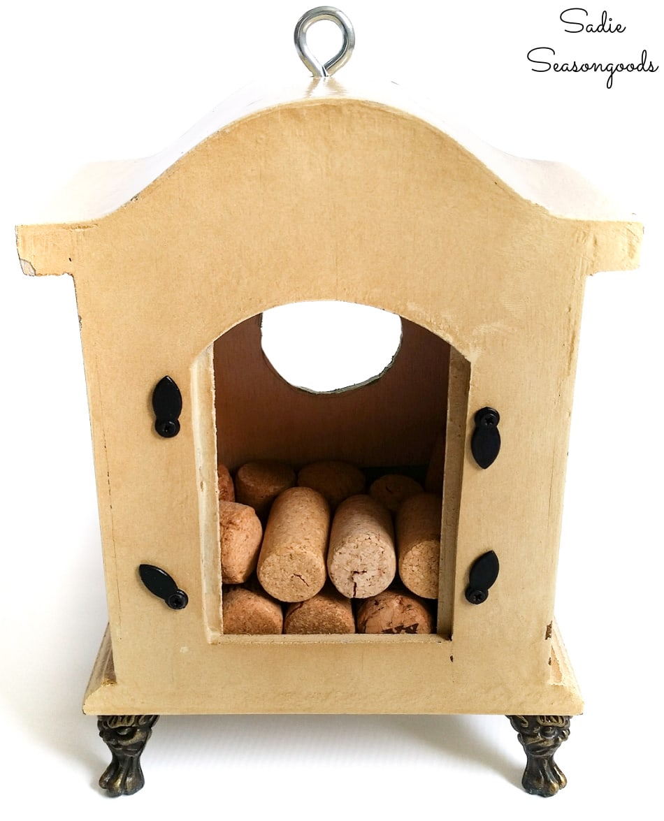 Wine corks inside an upcycled birdhouse