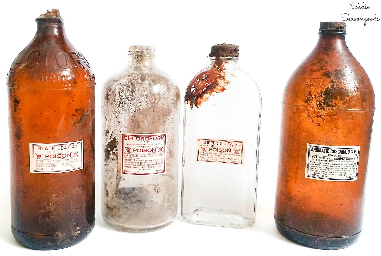 Antique poison bottles as apothecary decor for Halloween
