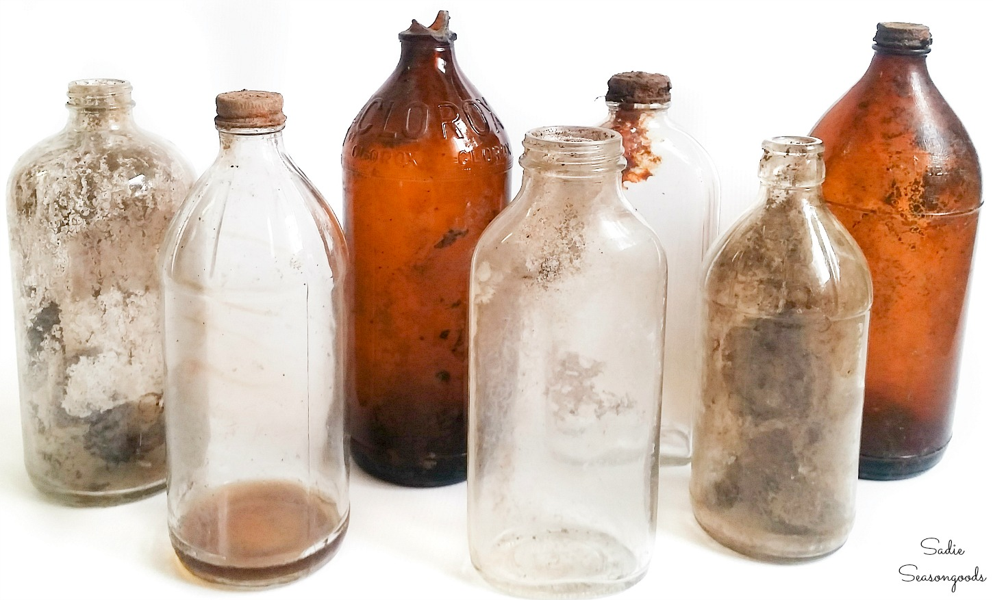 Old glass bottles from bottle digging to be used as Halloween poison bottles