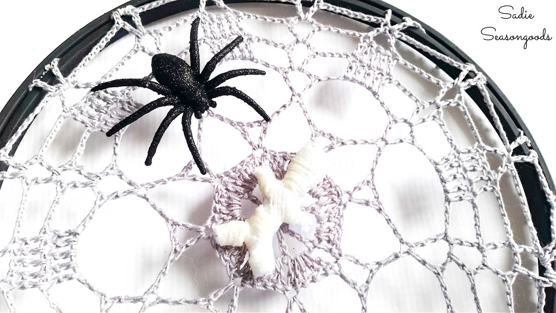 spider decor on a crochet spider web