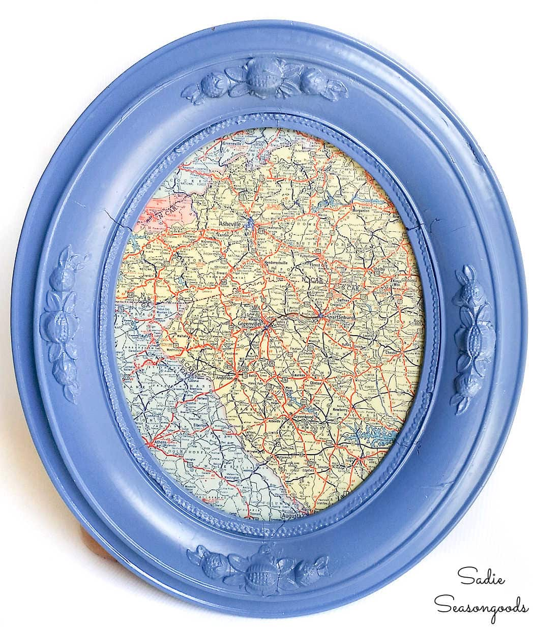 vintage road map in an antique oval frame