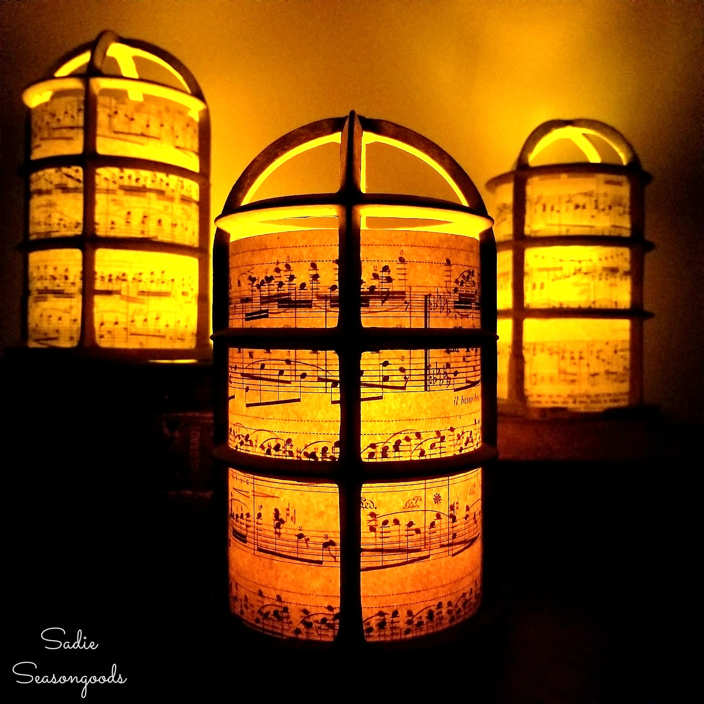 Christmas lantern for a rustic Christmas by upcycling the light bulb cages into luminaries with sheet music
