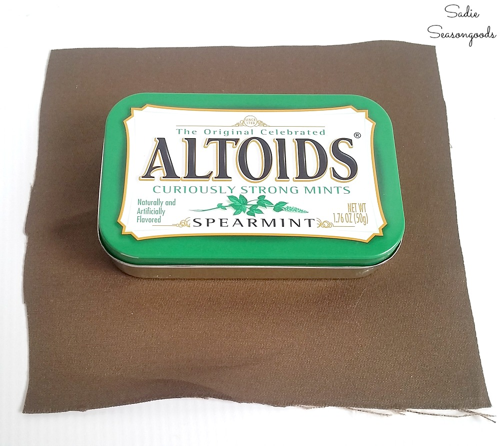 Covering an Altoids tin in fabric to make it look like the vintage luggage as a Christmas ornament