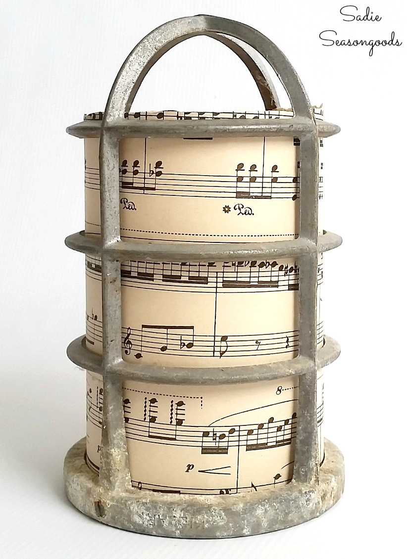 Repurposing the light bulb cages and vintage sheet music into the Christmas luminaries for rustic decor