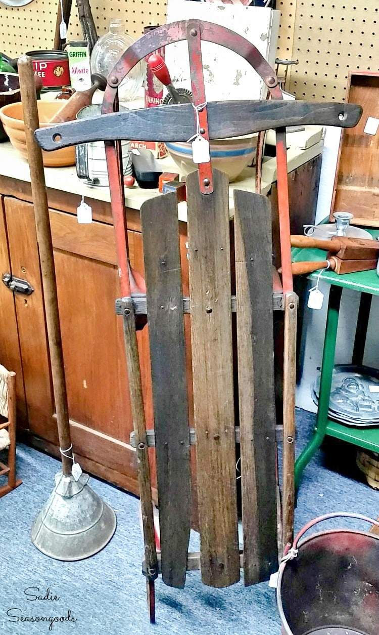 Vintage wooden sled at an antique store
