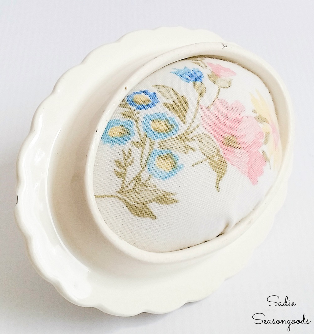 Adding a needle cushion for sewing supplies in the lid of a vintage teapot