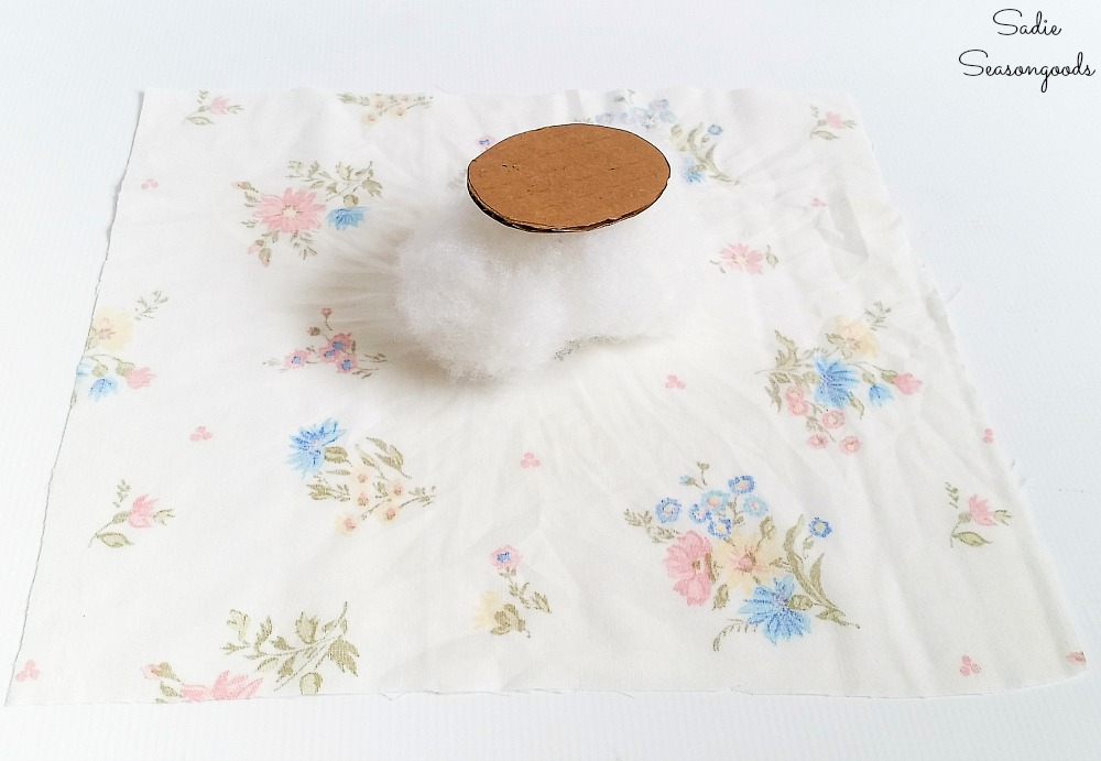 Needle cushion for a vintage teapot with fiber fill and a vintage bed sheet
