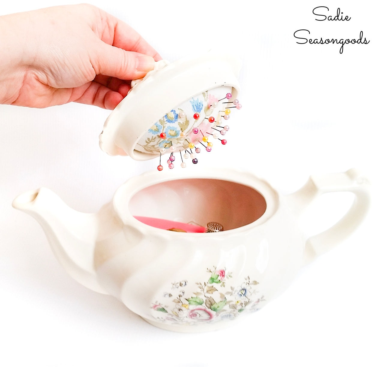 vintage teapot as a sewing caddy