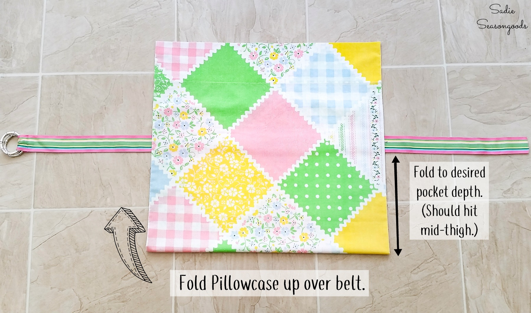 Folding a vintage pillow case to make a half apron with a fabric belt