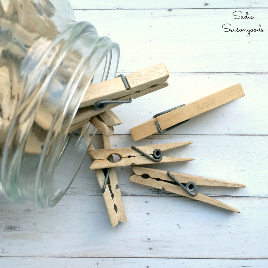 Wooden clothespins or wood clothespins to use as garage storage solutions for garden gloves by Sadie Seasongoods