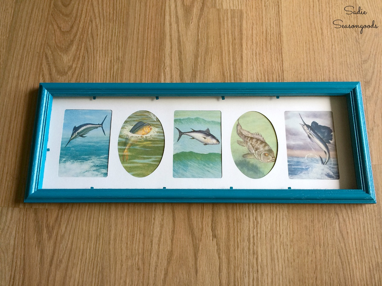 Spray painting a wooden picture frame or collage photo frame to become some coastal wall decor by Sadie Seasongoods