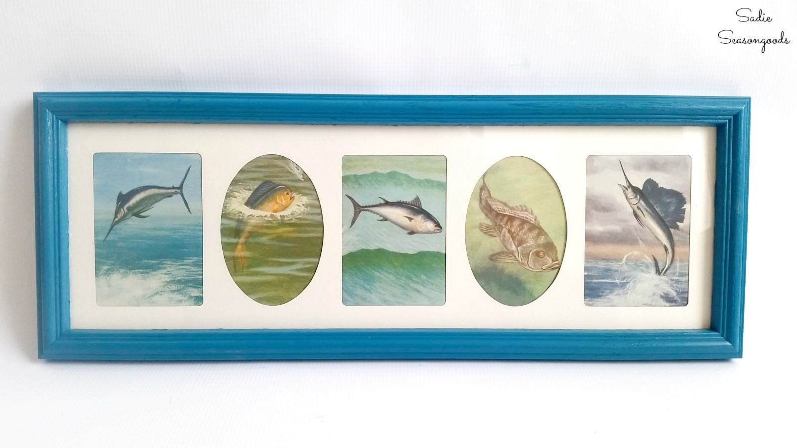 Coastal wall decor by upcycling a thrift store book and a collage photo frame by Sadie Seasongoods