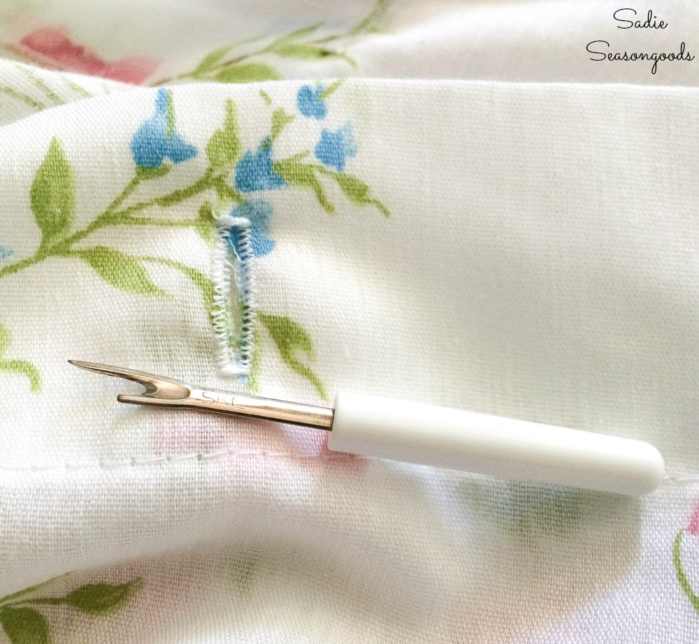 Sewing buttonholes on a cloth shower curtain from vintage bed sheets