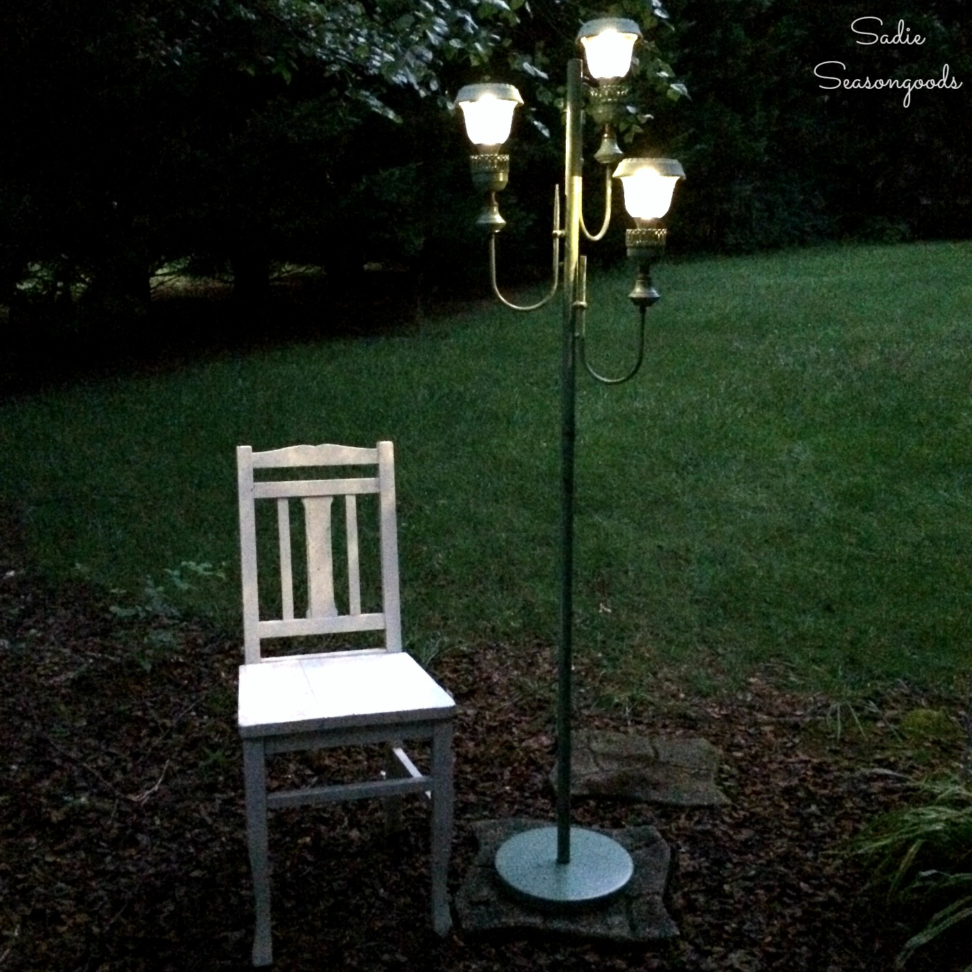 How to upcycle an antique floor lamp using small solar lights or solar driveway lights for backyard decor by Sadie Seasongoods