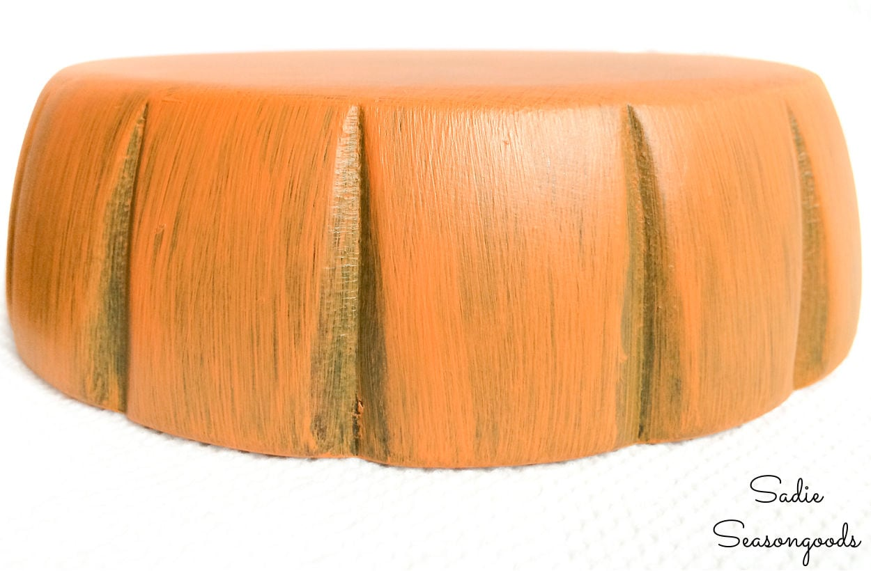 painting small wooden bowls to look like a pumpkin