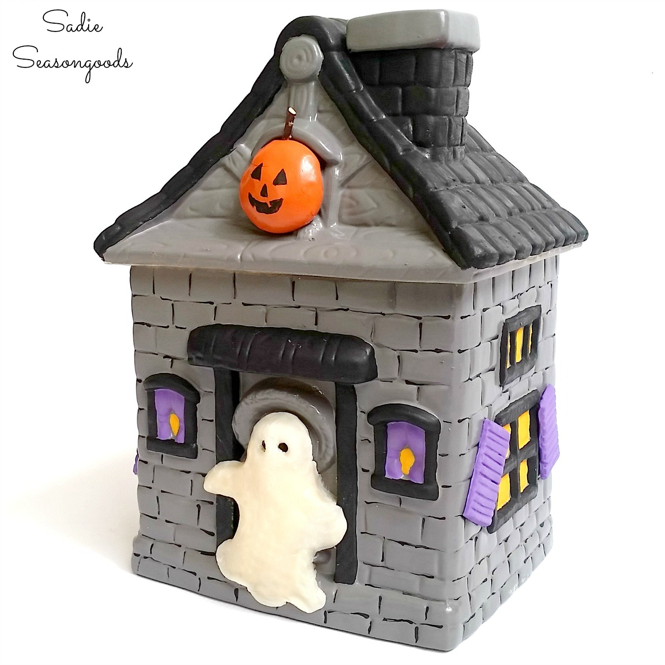 Halloween cookie jar and haunted house decor from giving a Halloween makeover to a vintage cookie jar by Sadie Seasongoods