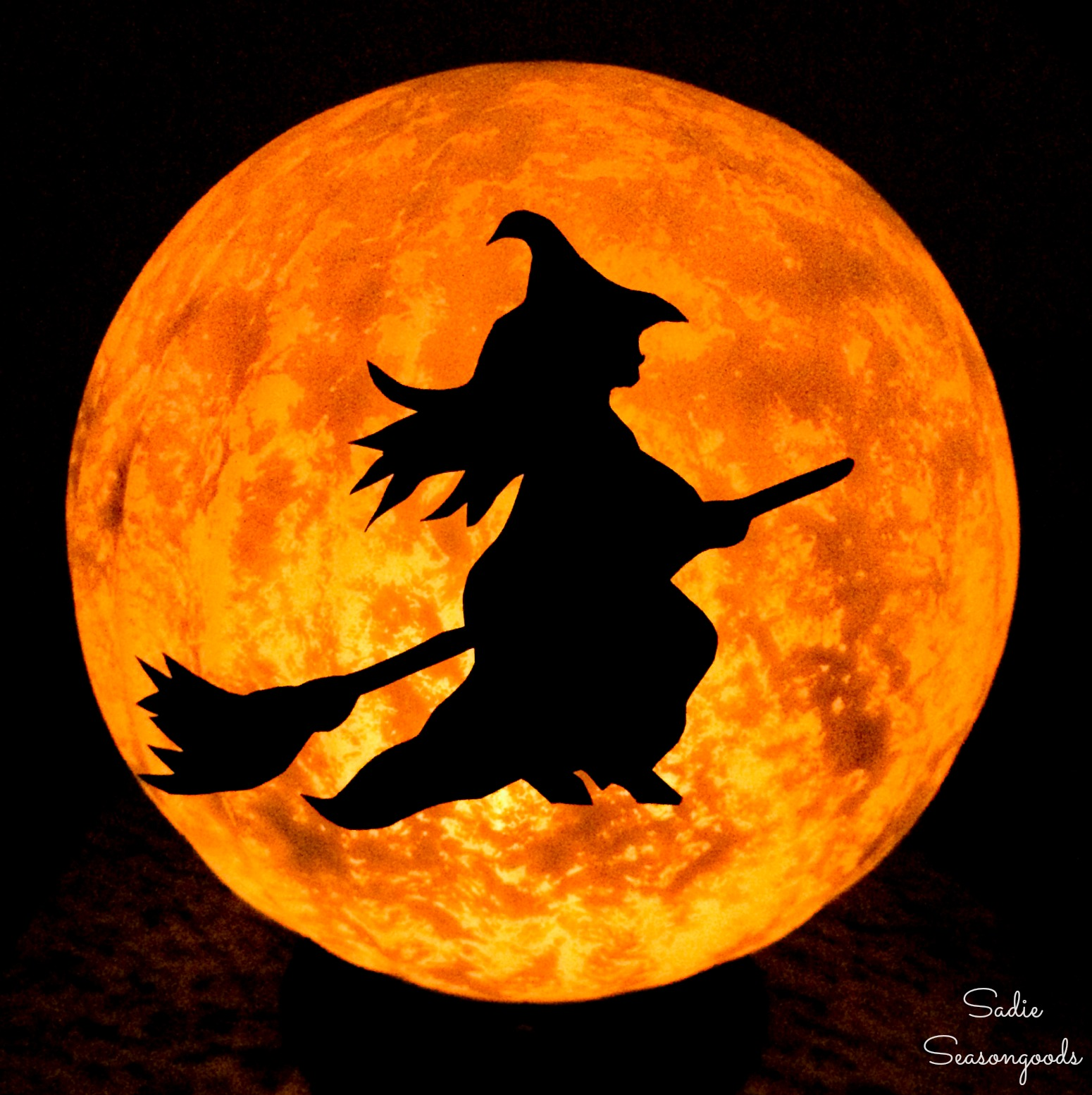 Halloween Moon and Witch Decor from a Glass Globe Light Fixture