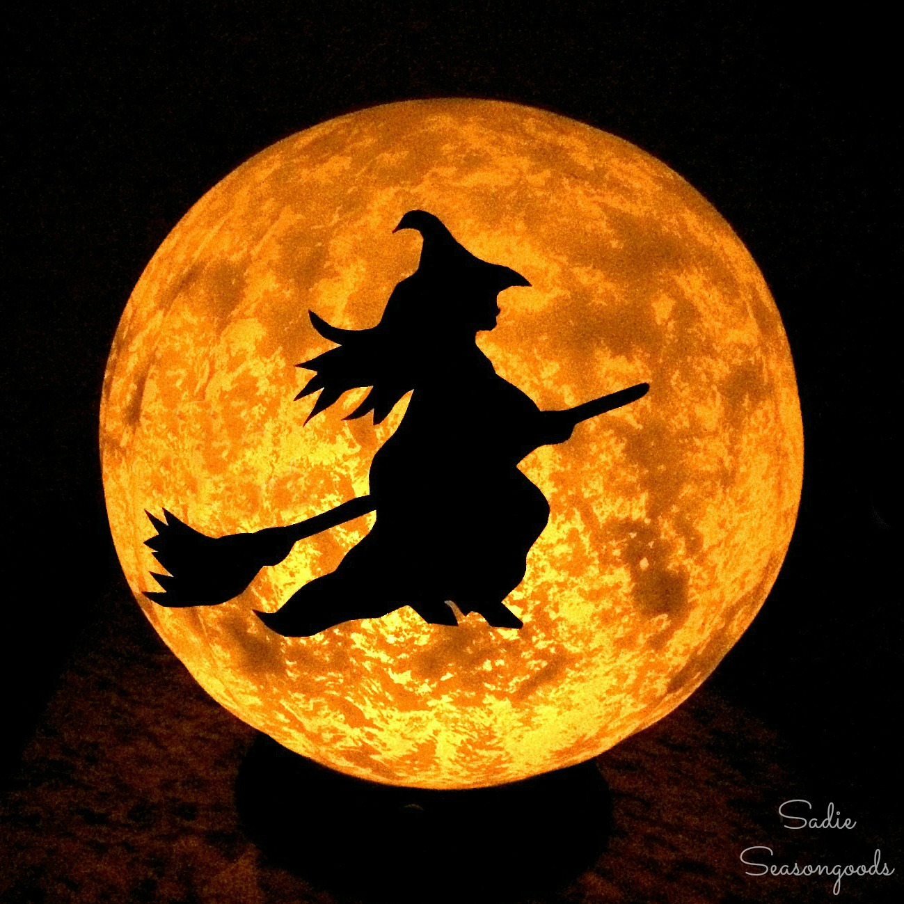 Halloween moon by upcycling a vintage light fixture into a light up moon with Halloween witch by Sadie Seasongoods
