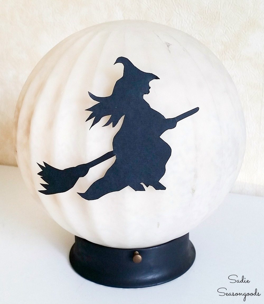 Witch decor on a light up moon