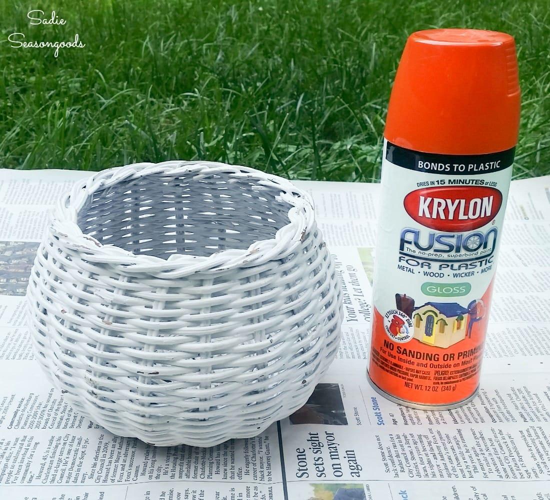 Making a pumpkin basket with orange spray paint