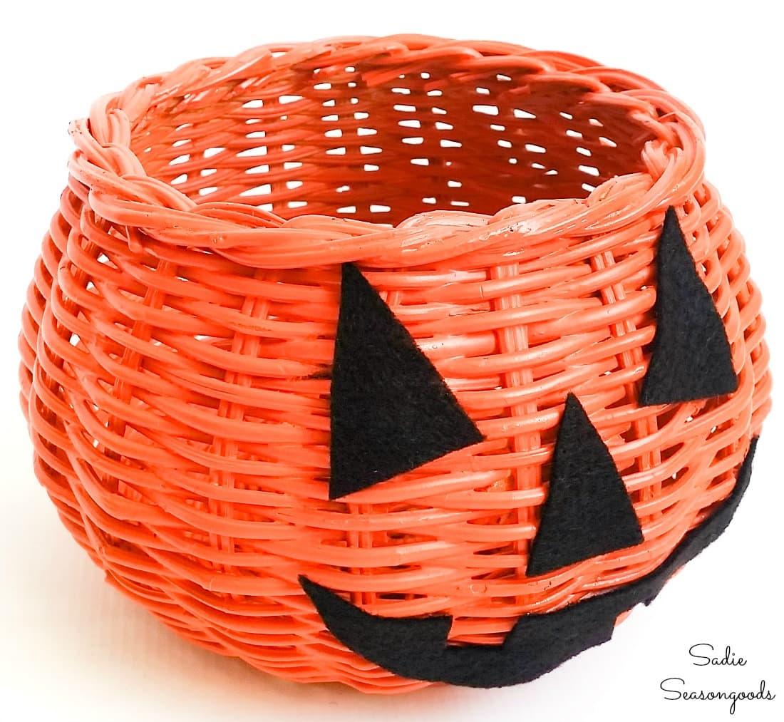 Painting a basket to look like a jack o lantern