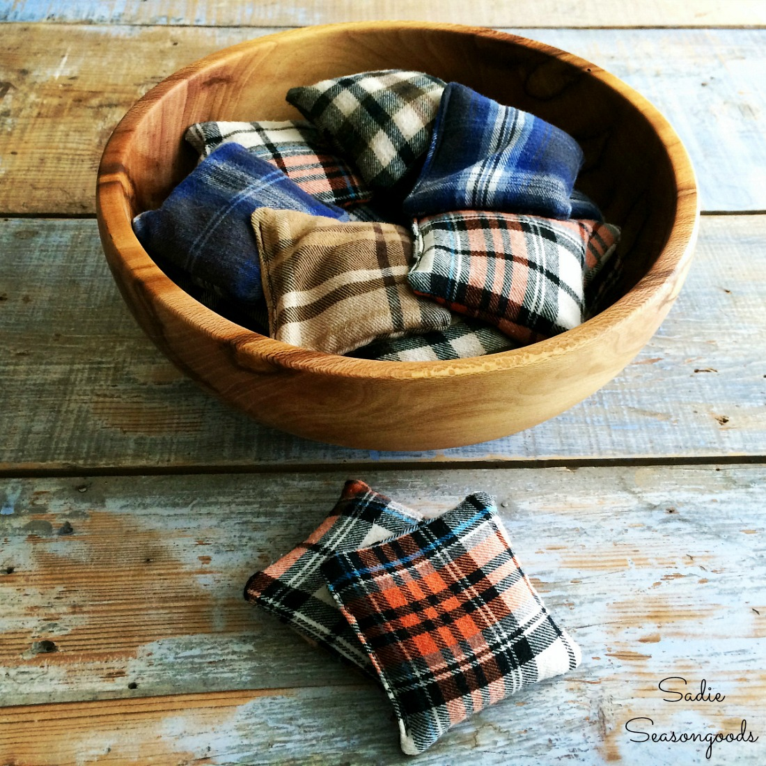 DIY hand warmers or football hand warmers that are a scrapbuster that uses flannel fabric from upcycled clothing for an autumn craft