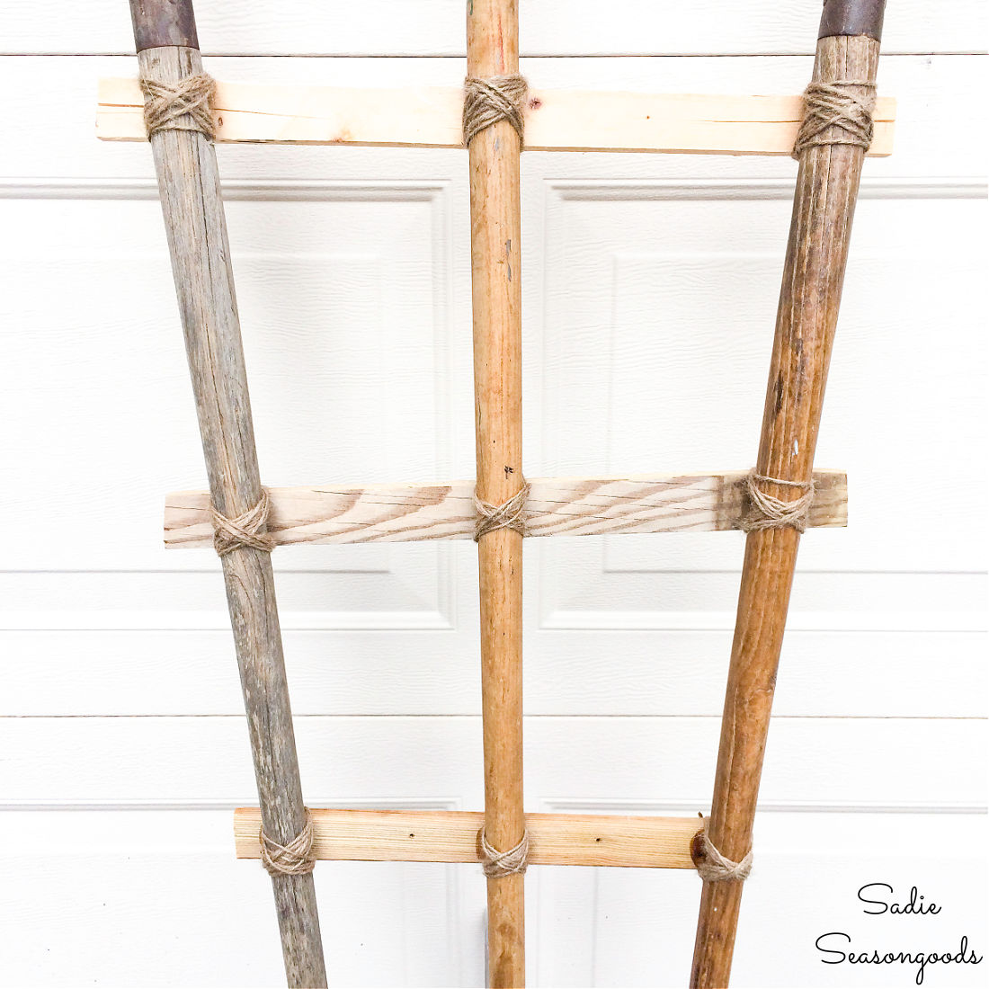 DIY garden trellis with antique garden tools