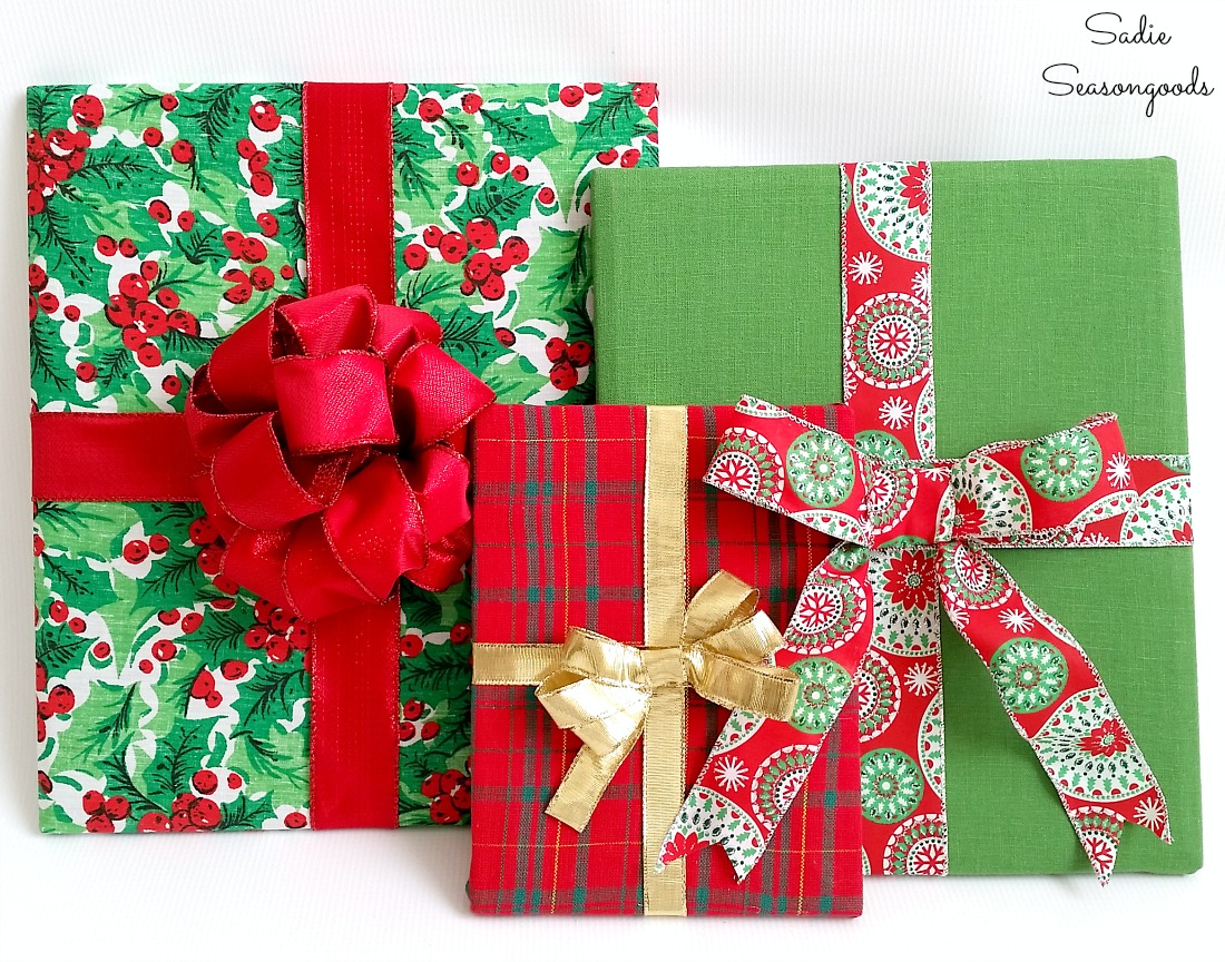 Cheap Christmas decorations by upcycling the wooden frames and Christmas placemats into wrapped gifts by Sadie Seasongoods