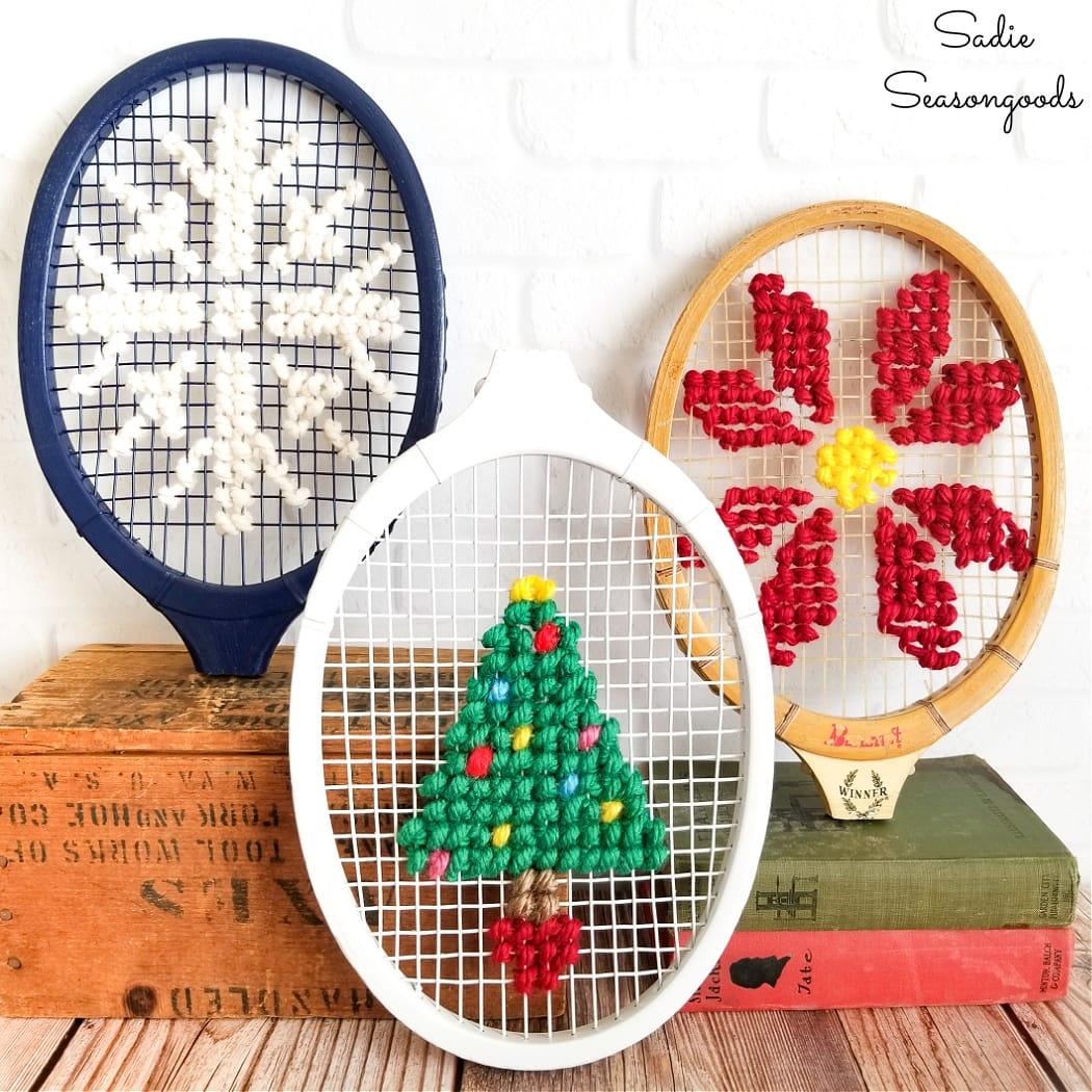 Christmas cross stitch on a wooden tennis racket