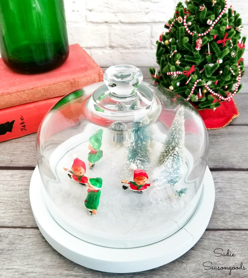 Glass cheese dome with Christmas winter scene