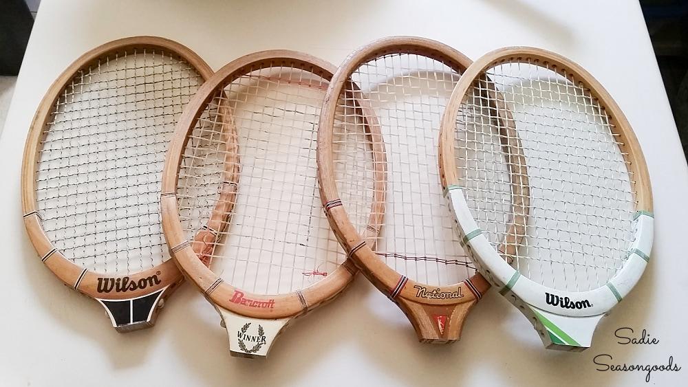 Heads of wooden tennis rackets