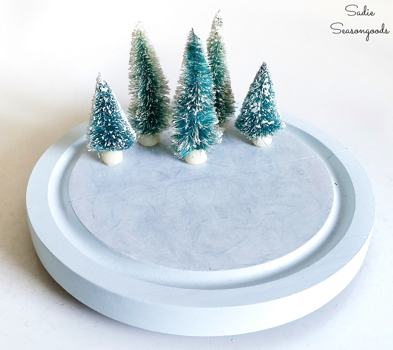 Vintage bottle brush trees for a winter Christmas scene
