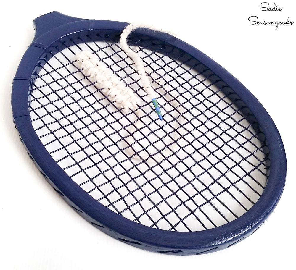 Yarn cross stich on a vintage tennis racket